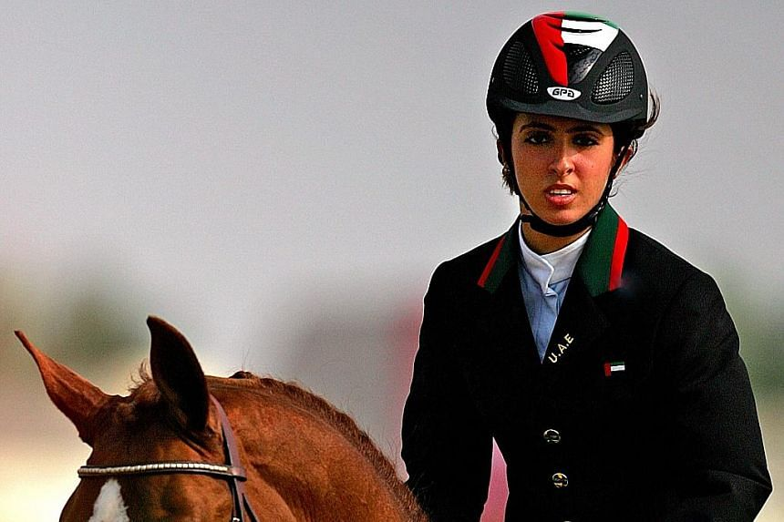 Sheikha Latifa, daughter of Sheikh Mohammed bin Rashid Al Maktoum, at an equestrian event at the 15th Asian Games in Doha in 2006. A British court found that she was kidnapped in 2018 by her father - just as he had her elder sister Shamsa abducted fr