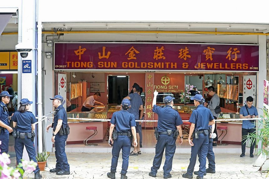 Police officers standing outside Tiong Sun Goldsmith & Jewellers in Bukit Merah, after the theft of a gold necklace on March 7, 2020.