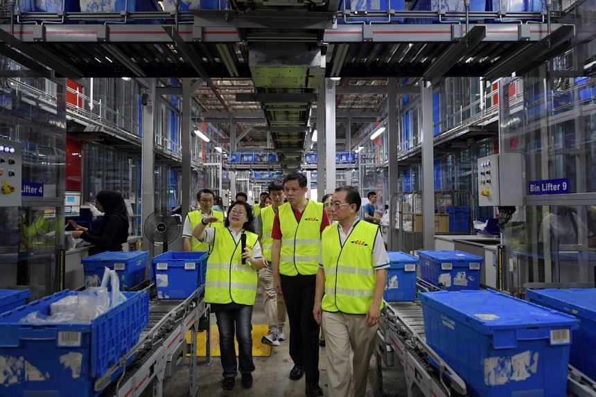Accompanied by Mr Seah Kian Peng, Group Chief Executive Officer, FairPrice Group; and Mdm Toh Hui Leng (left), Fairprice Chief Supply Chain Officer, Minister for Trade and Industry Chan Chun Sing (centre) tours the Fairprice Benoi Distribution Centre