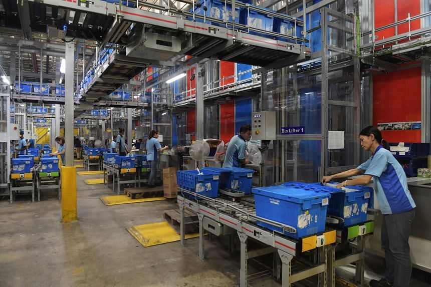 Pickers pack online orders at the Piece Fulfillment Centre at the Fairprice Benoi Distribution Centre.