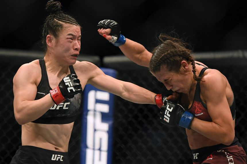 Weili Zhang (left) punches Joanna Jedrzejczyk during her split decision win to retain her strawweight title at T-Mobile Arena in Las Vegas on March 7, 2020.