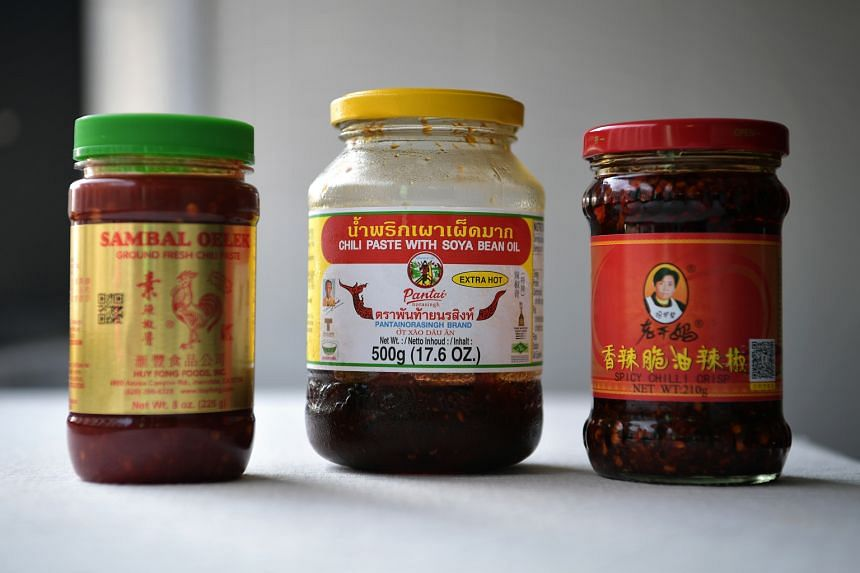 Ingredients include tamarind paste and sambal oelek, Thai chilli paste or Lao Gan Ma chilli (above).