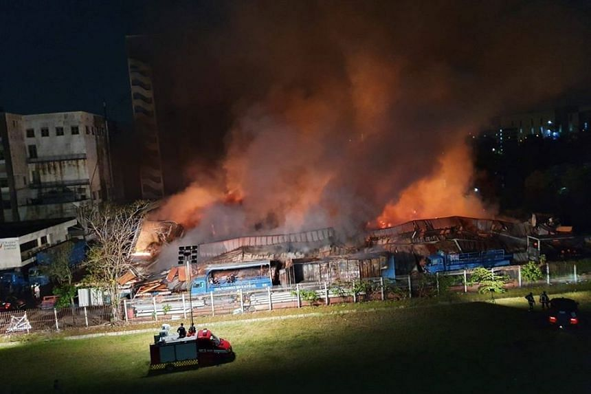 A fire broke out at a warehouse in an industrial area near Jurong River on Monday night.