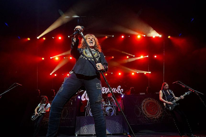 Veteran German hard rock band Scorpions' guitarist Rudolf Schenker and British hard rock band Whitesnake's singer David Coverdale (above) and their bandmates got the audience pumping their fists in the air and singing their voices hoarse to crowd-pleasing