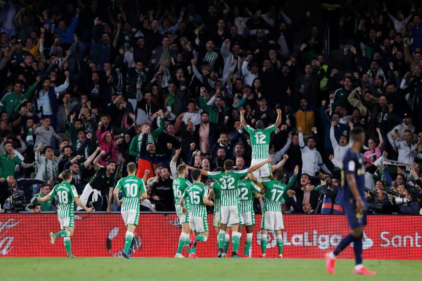 Real Betis' Sidnei celebrates scoring their first goal with teammates during the La Liga football match against Real Madrid in Seville, Spain, March 8, 2020.