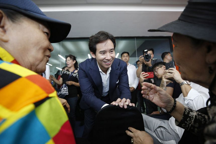 Interim leader of the remaining 55 MPs of Thailand's dissolved Future Forward Party, Mr Pita Limjaroenrat, talking to supporters after the inauguration of the new Move Forward party in Bangkok yesterday. The new party's launch came just over two week
