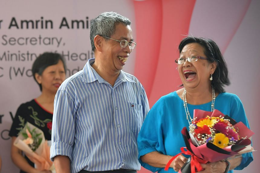 Mrs Molly Shoo, 70, winner of the Lifelong Learner award at the Sembawang GRC Women's Festival, with her husband Shoo How Beng, 68. She serves with the Singapore Red Cross and takes art therapy and cooking courses. Madam Emalin Rom, 71, was honoured
