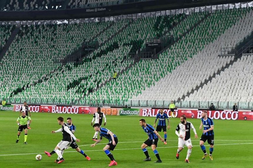 Inter Milan and Juventus players compete in an empty stadium in Turin, Italy, on March 8, 2020.