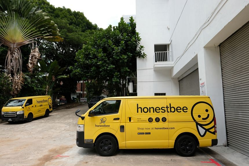 A photo of Honestbee delivery vans outside its Habitat supermarket premises at 34 Boon Leat Terrace.