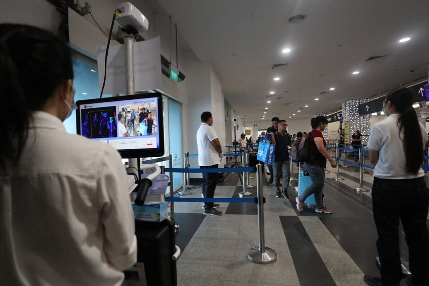 Passengers arriving at the Singapore Cruise Centre being screened by thermal scanners on March 5, 2020.