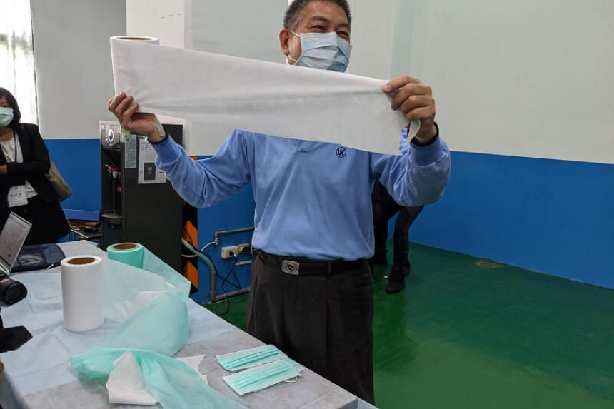 Universal Incorporation's plant manager Chen Ching-feng shows reporters materials used to make surgical masks at the Tainan-based factory on March 6, 2020.