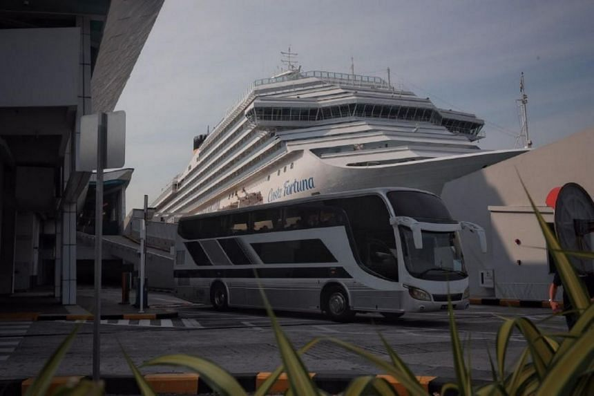 A bus leaving the Marina Bay cruise terminal on March 10, 2020.