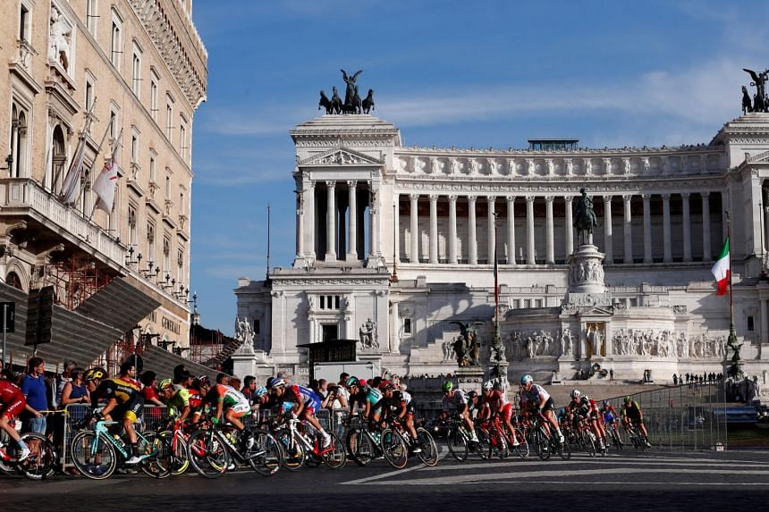 In a photo taken on May 27, 2018, riders pass by the Altare della Patria during the final stage of the Giro d'Italia.