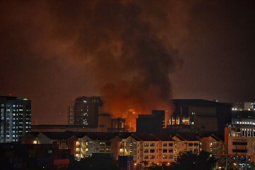 The fire at a warehouse located at 18 Jalan Besut as seen from Teban Gardens, on March 9, 2020.
