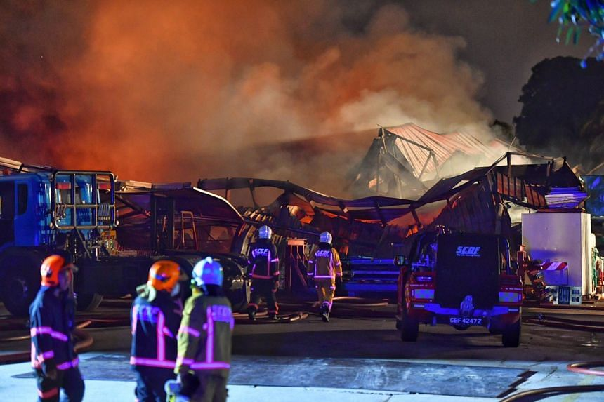 Firefighters battling the fire at a warehouse located at 18 Jalan Besut, on March 9, 2020.