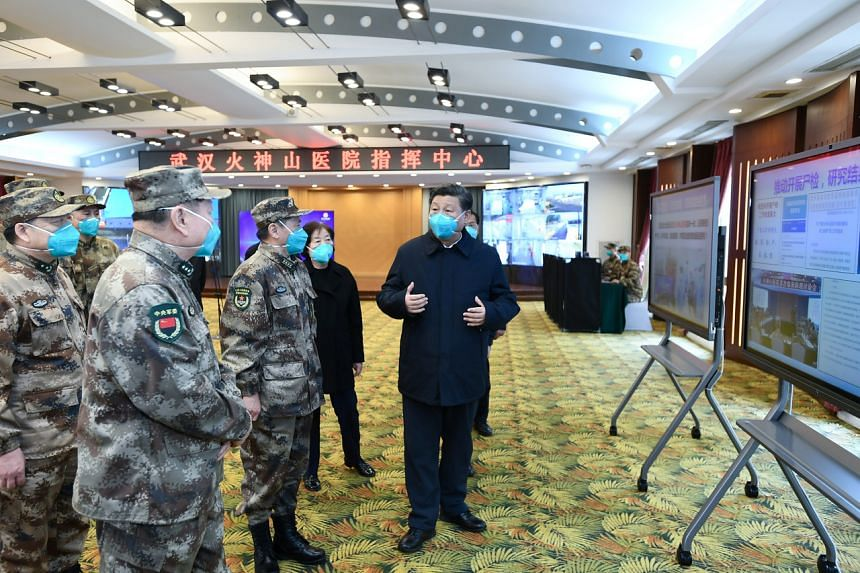 Chinese President Xi Jinping speaks with staff at the Huoshenshan Hospital in Wuhan, China, on March 10, 2020.