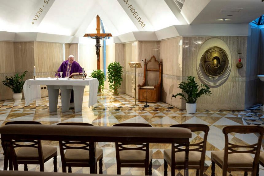 Pope Francis celebrates a daily mass alone in the Santa Marta chapel at the Vatican, as part of precautionary measures against the spread of the new coronavirus, on March 10, 2020.