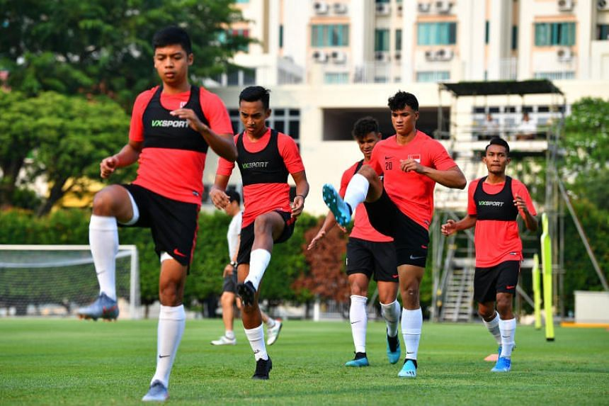 Ikhsan Fandi (second from right) training at Geylang Lorong 12 field on Sept 3, 2019.