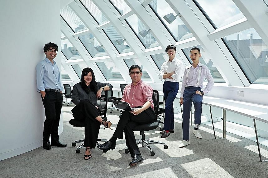Working on the five-year research programme in computational law are (from left) Professor Goh Yihan, dean of Singapore Management University School of Law; Ms Alexis Chun and Mr Wong Meng Weng, co-founders of local legal tech start-up Legalese; and