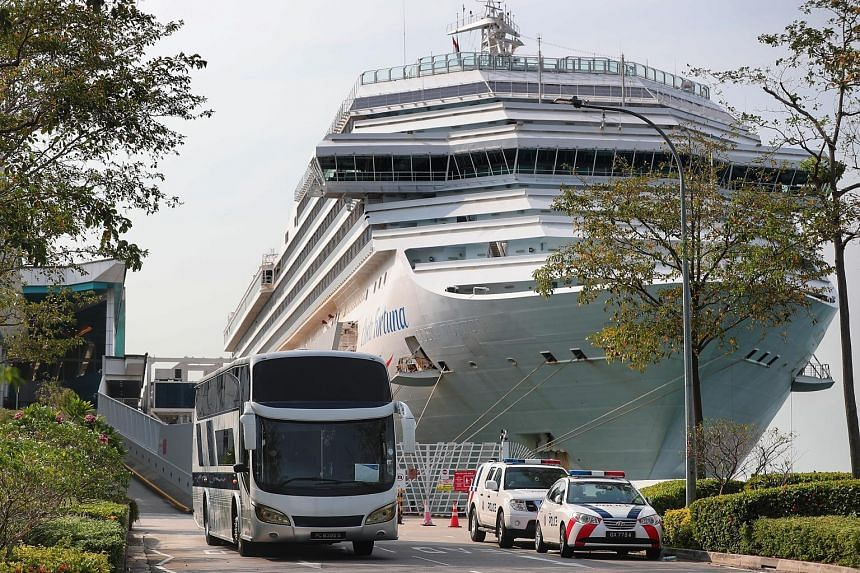 The Costa Fortuna docked at the Marina Bay Cruise Centre around 7.35am yesterday. Passengers began leaving the ship from about 8.40am and boarded buses heading for Changi Airport and various hotels.