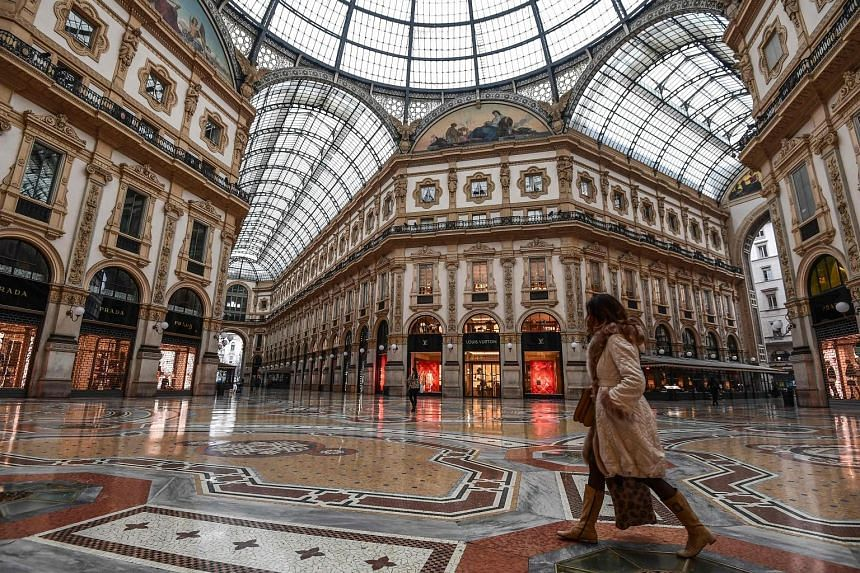 Rome's Spanish Steps left virtually deserted as the nationwide clampdown took effect yesterday. Other landmarks were also closed or empty. A near-empty shopping mall yesterday in Italy's financial capital Milan, which is already under stricter contro
