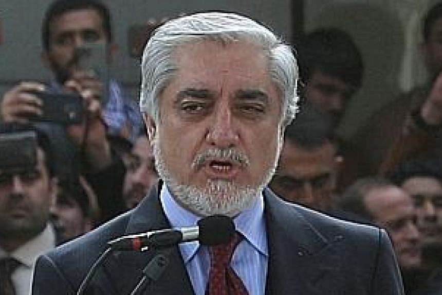 Mr Abdullah Abdullah swore himself in as Afghan premier on Monday, in a move denounced by the US.