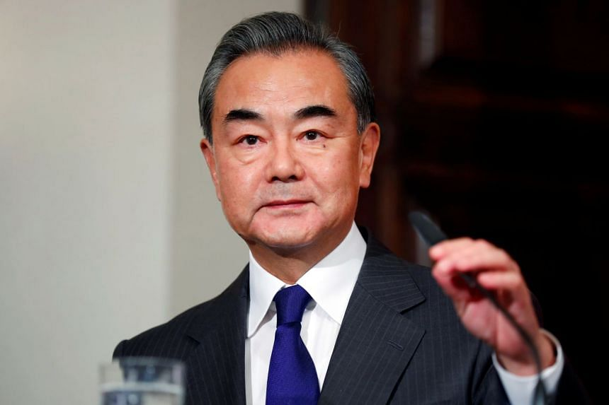In a photo taken on Feb 14, 2020, Chinese Foreign Minister Wang Yi holds a news conference in Berlin.