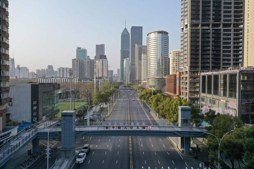 An aerial view of an almost empty street in Wuhan, China. A former senior official in the epicentre of the new coronavirus outbreak in China has been charged with corruption.