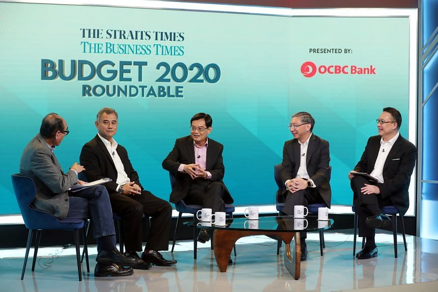 (From left) ST associate editor Vikram Khanna with panellists: IPS senior research fellow Faizal Yahya, DPM Heng Swee Keat, OCBC Bank head of global commercial banking Linus Goh and Ademco Security Group managing director Toby Koh.