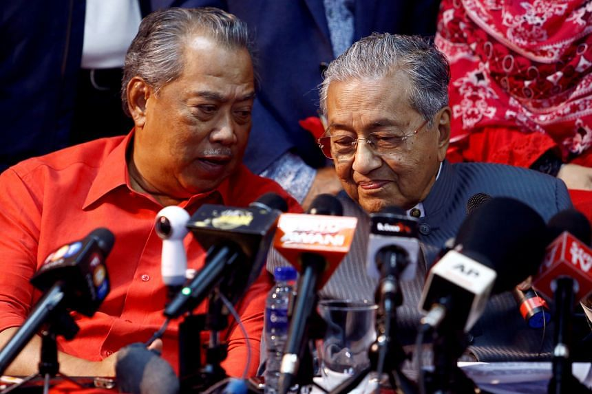 Former Malaysian prime minister Mahathir Mohamad and Tan Sri Muhyiddin Yassin during a news conference on April 5, 2018.