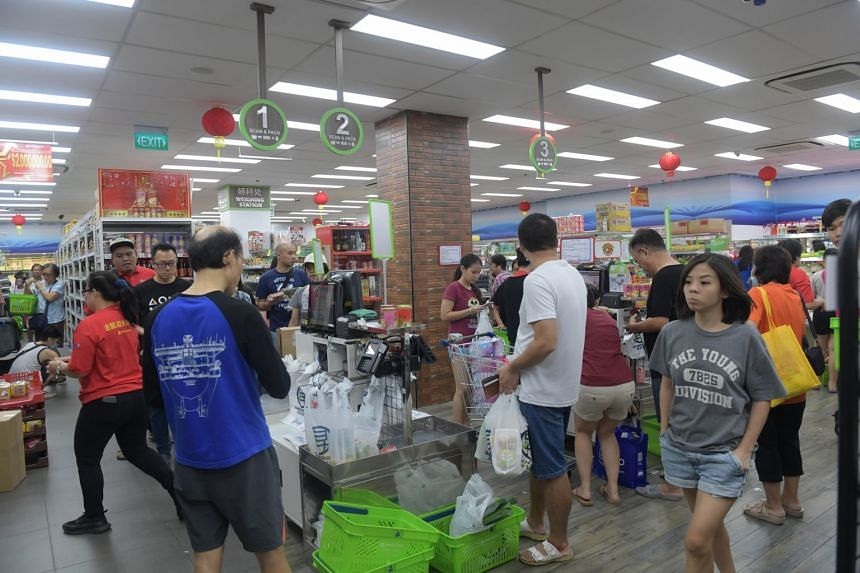 Shoppers at a Sheng Siong supermarket in Canberra on Feb 8, 2020, the day after Singapore's alert level was raised to orange.