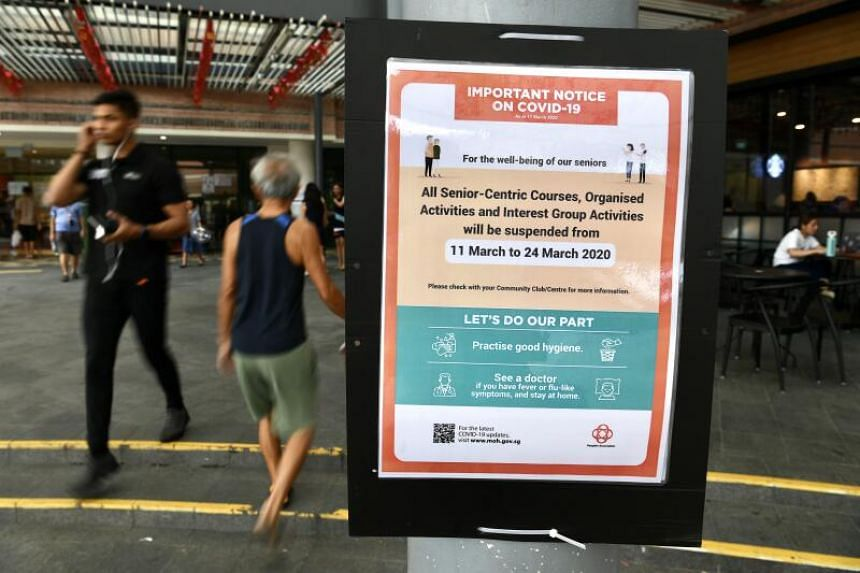 A notice at Bishan Community Club declaring that all social activities for seniors organised by government agencies will be suspended for 14 days.