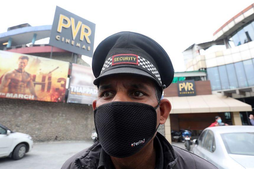 A security guard wears a face mask as a precautionary measure against coronavirus in Jammu, India.