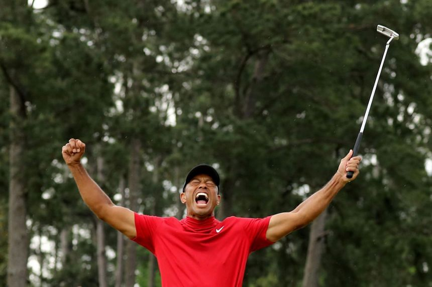Woods celebrates on the 18th hole after winning the 2019 Masters.