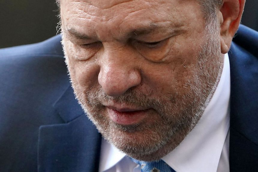 A February 2020 photo shows film producer Harvey Weinstein arriving for his trial in New York