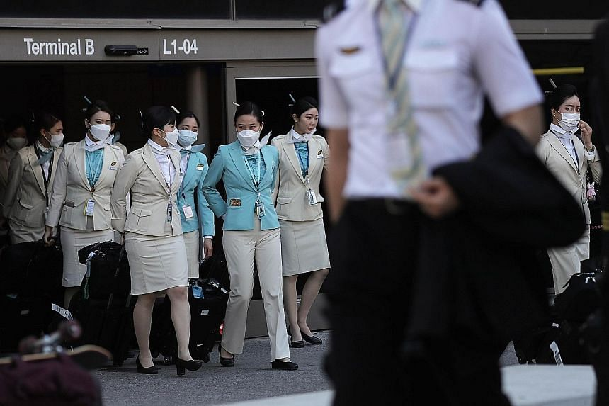 A Korean Air crew departing the international terminal after arriving at Los Angeles International Airport last month. The global airline industry has been among the sectors hardest hit by the coronavirus outbreak, losing almost a third of its value