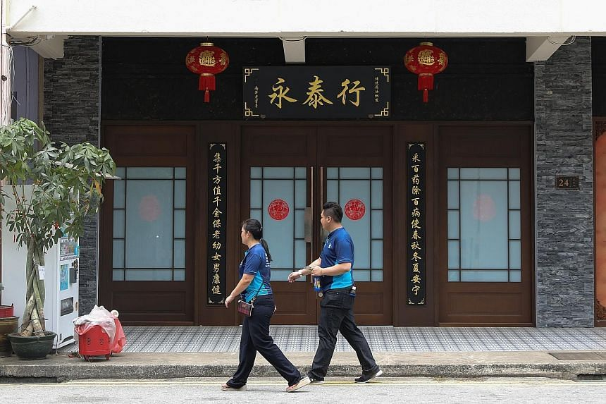 Health products store Yong Thai Hang in Cavan Road was closed when The Straits Times visited yesterday. The store was the first local cluster to be discovered in Singapore, with nine cases in total. A Grand Hyatt Singapore employee disinfecting a sea