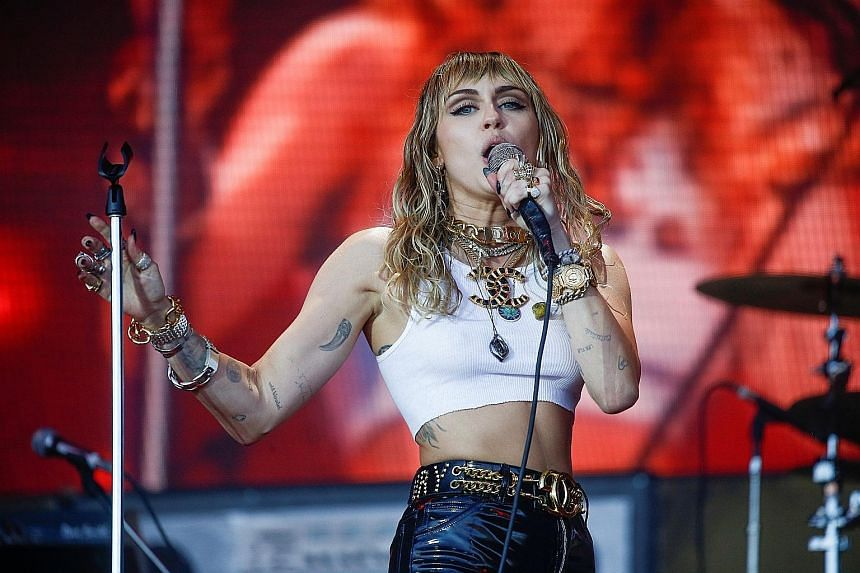 Pop star Madonna (right) has called off two concerts in Paris, France, while fellow singer Miley Cyrus (below right) has cancelled a trip to Melbourne, Australia, where she was to perform at a bush-fire relief concert tomorrow.