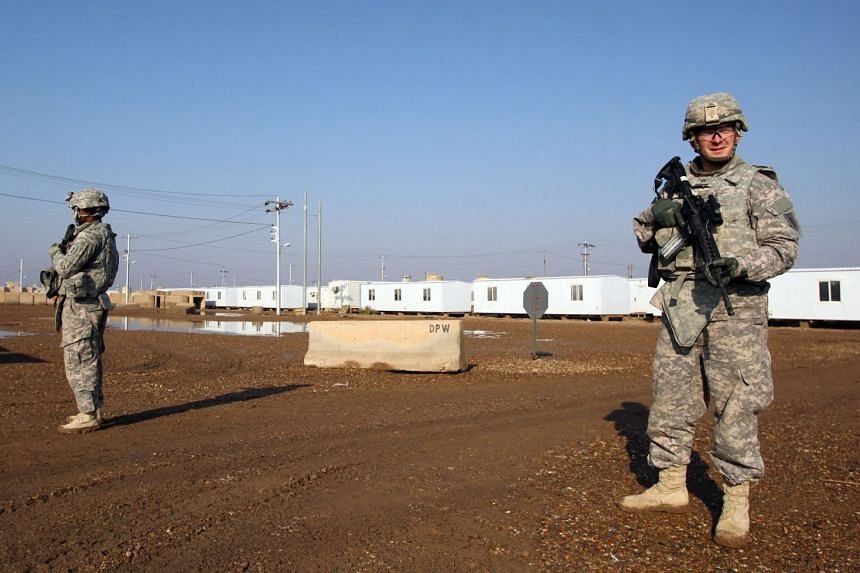 A 2014 photo shows US soldiers patrolling at the Taji base complex in Iraq.