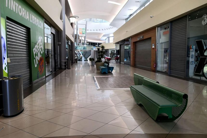 Closed shops inside a mall in Padua, northern Italy, on March 8, 2020.