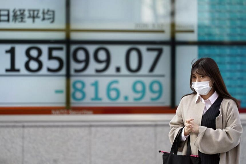 A stock market indicator board in Tokyo on March 12, 2020.
