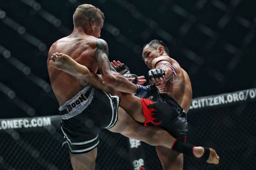 A photo taken on Feb 28, 2020, shows Australia's Rocky Ogden and Thailand's Sam-A Gaiyanghadao during their Strawweight Muay Thai World Championship bout in One Championship's King of the Jungle event at the Singapore Indoor Stadium.
