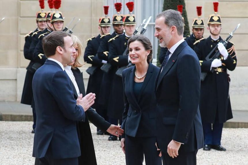 French President Emmanuel Macron (left) greeted Spain's King Felipe VI and Queen Letizia by replacing the traditional handshake with an Indian-style namaste, pressing his palms together and bowing slightly, at the Elysee presidential Palace in Pari