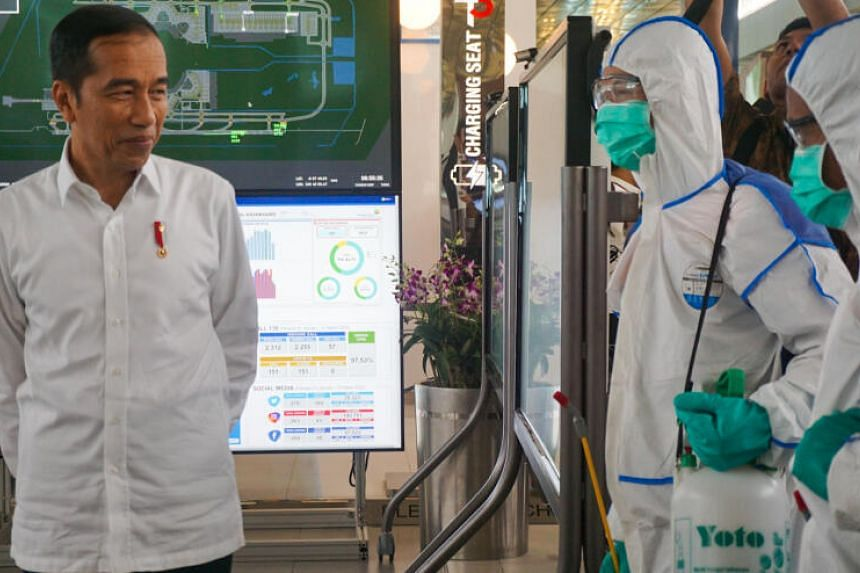 Indonesian President Joko Widodo inspects Jakarta International Airport in Tangerang on March 13, 2020, of its preparation to fight against the spread of the coronavirus.