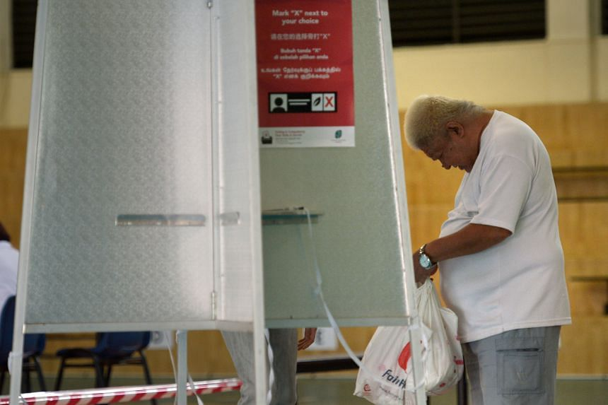 A voter at a polling centre in Pei Chun Public School in Toa Payoh Lorong 7 on Sept 11, 2015.