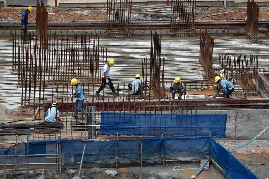 Workers at a construction site in Kim Keat Avenue, on Nov 5, 2019.