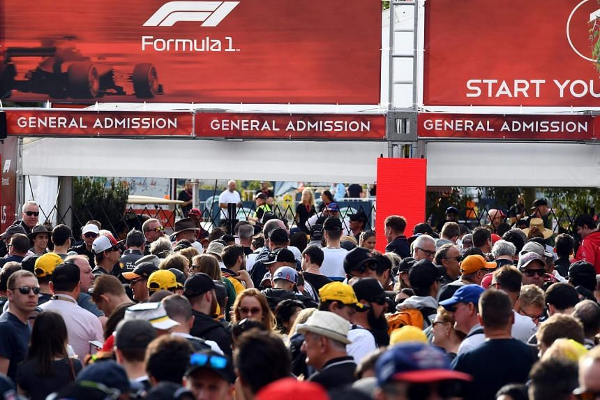 Fans queue up outside the gates prior to the first practice session for the Formula One Australian Grand Prix before it was cancelled, in Melbourne on March 13, 2020.