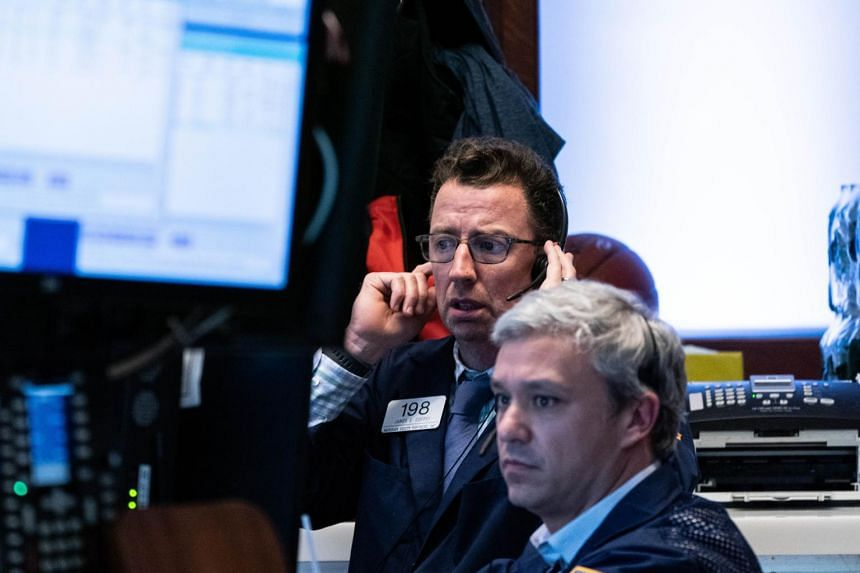 Traders work on the floor of the New York Stock Exchange on March 12, 2020.