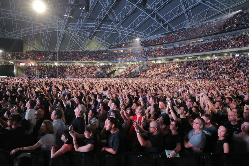 In a photo taken on Nov 30, 2019, concertgoers watch rock icons U2 perform at the National Stadium.
