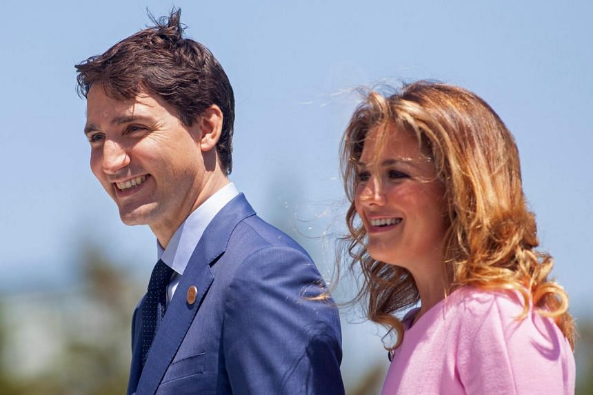 Canadian Prime Minister Justin Trudeau and his wife Sophie Gregoire Trudeau. Mr Trudeau is not currently showing any symptoms of coronavirus.